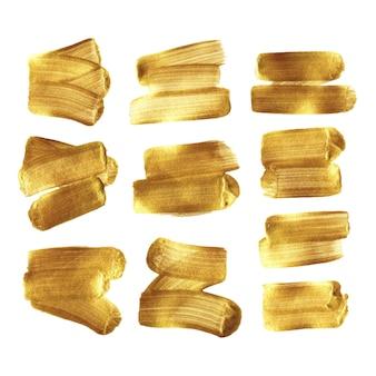 Gold paint brush stroke smear set isolated