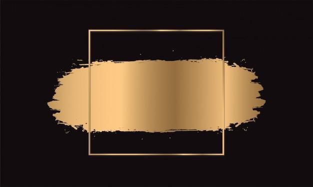 Gold paint brush strokes. frame golden on black background.