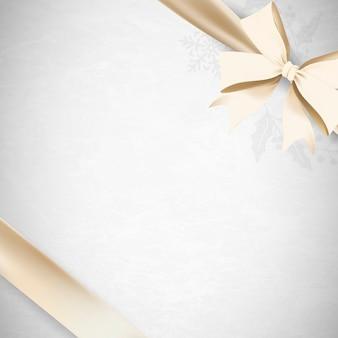 灰色の背景にゴールドのリボンの弓