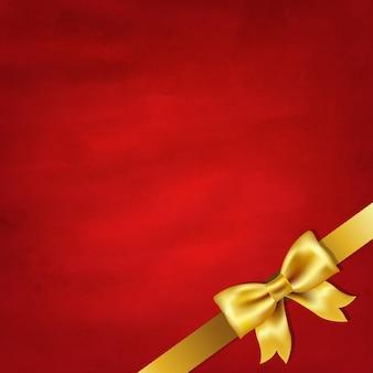 Золотой атласный бант и красный старинный фон