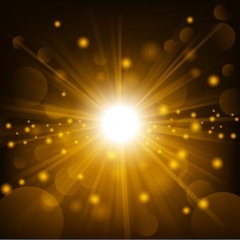 レンズフレアの背景に金色の輝き