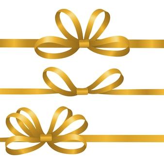 Золотые шелковые ленты. атласные элементы бантов. реалистичные ленты для подарочной упаковки на белом фоне