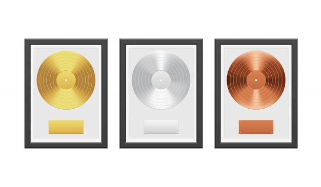 Gold, silver and bronze vinyl record with black frame on white brick wall