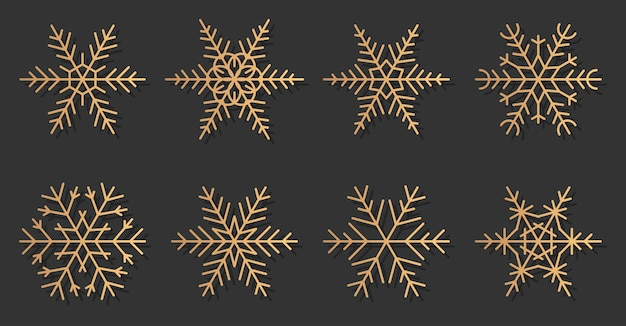 Gold snowflakes elegant silhouettes icons set. great for decoration banner merry christmas and happy new year. trendy golden gradient different shapes of snow.