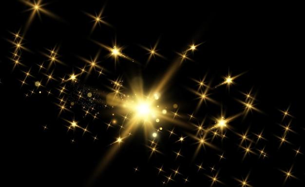 Золотые блестки, волшебство, яркий световой эффект на прозрачном фоне.