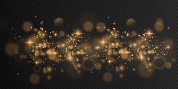 Золотая сверкающая пыль с золотыми сверкающими звездами на прозрачном фоне