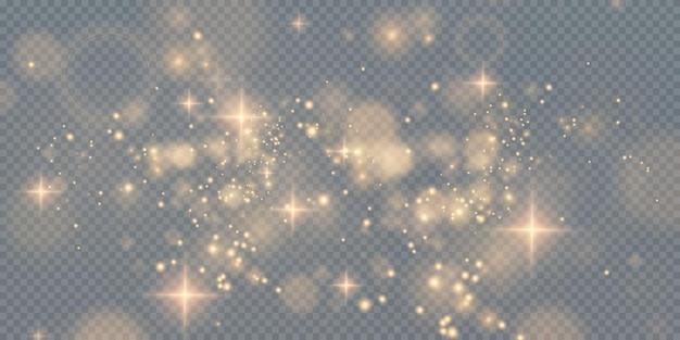 透明な背景に金の輝く星と金の輝くほこり