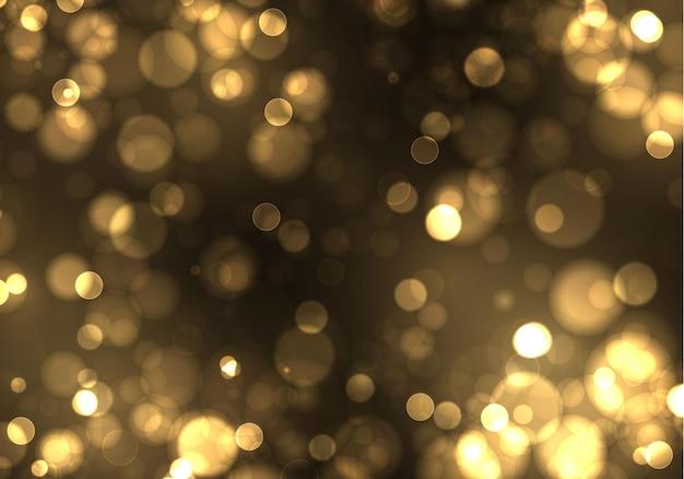 ゴールドスパークリングマジカルゴールドイエローダスト粒子。ボケ効果。 Premiumベクター