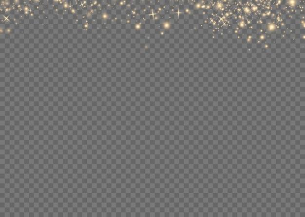 金色の火花と金色の星が特別な光の効果を輝きます。透明な背景の上で輝きます。