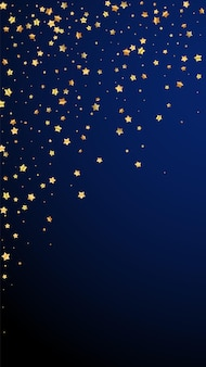 Gold stars random luxury sparkling confetti. scattered small gold particles on dark blue background. emotional festive overlay template. imaginative vector background.