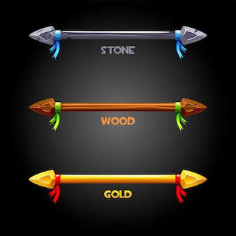 Gold, wooden, stone spears with a ribbon for the flag. vector set of icons of old weapons for the game.