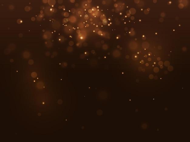 黄金の抽象的な豪華なボケ味の背景。光の効果の金の火花。クリスマスのぼかしの概念。ベクトル黄色のスパークリング落下紙吹雪の背景。光沢のあるボリュームは、黒い背景に星のほこりをぼやけさせました。