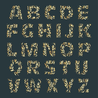 Golden alphabet with elegant flowers on letters