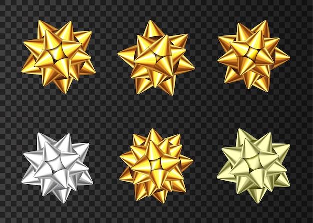Золотые и серебряные декоративные бантики подарка, изолированные на темном фоне. рождество, новый год, украшение на день рождения. элемент дизайна праздник вектор для баннера, поздравительных открыток, плакатов.