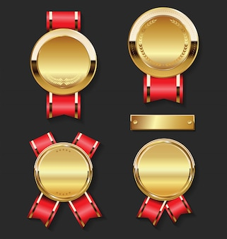 Golden award medal with red ribbons set