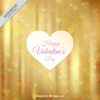 Golden background with bokeh effect for valentine's day
