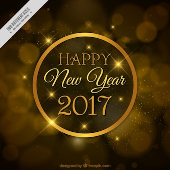 Golden bokeh background of happy new year 2017