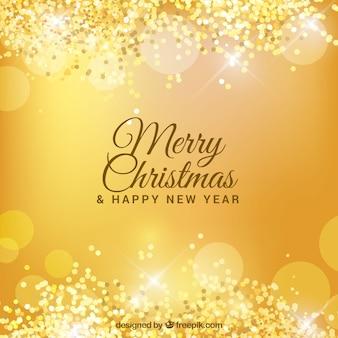 Golden bokeh background of merry christmas