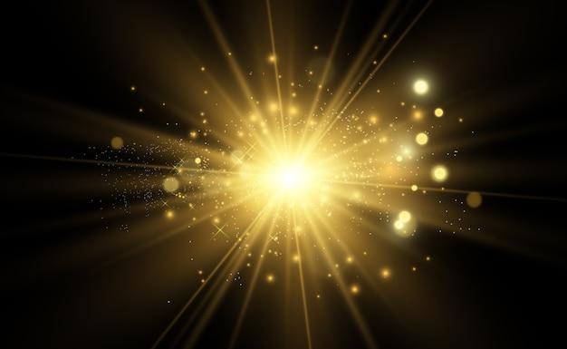 Золотая яркая звезда. световой эффект яркой звезды. красивый свет для иллюстрации. звезда белые искры сверкают особым светом. блестки на прозрачном фоне.