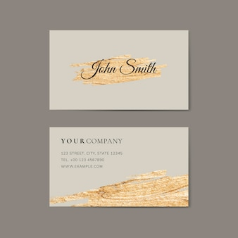 Golden brush stroke on a business card template