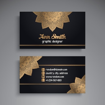 Golden business card with mandala decoration