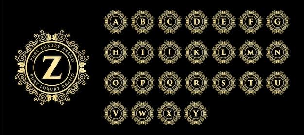 黄金の書道のフェミニンな花の手描きモノグラムアンティークビンテージスタイルの高級ロゴのデザインと装飾