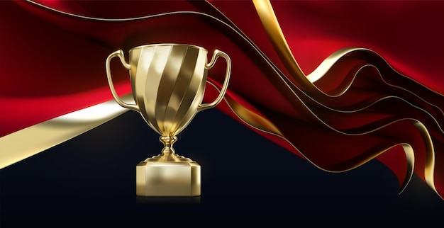 Golden champion cup with wavy red fabric sheets on black background