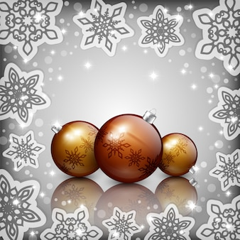 Golden christmas baubles on  grey background