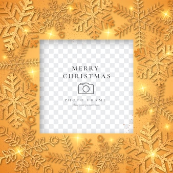 Golden christmas photo frame with shiny snowflakes