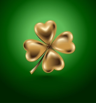Golden clover leaf, st. patrick day symbol. isolated four-leaf on green background. jewelry