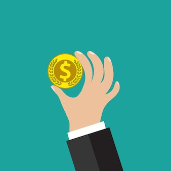 Golden coin in hand