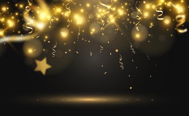 金色の紙吹雪がステージに落ちるストリーマー