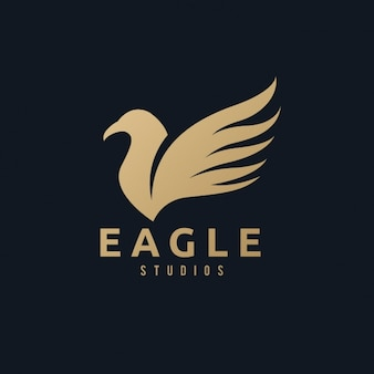 A golden eagle logo on a black background