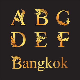 Golden elegant letter a, b, c, d, e, f with thai art elements.