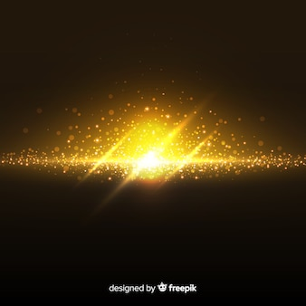 Golden explosion particle effect on black background