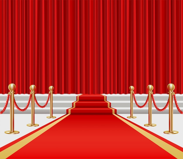 Golden fencing and red carpet with a rise on the stage.