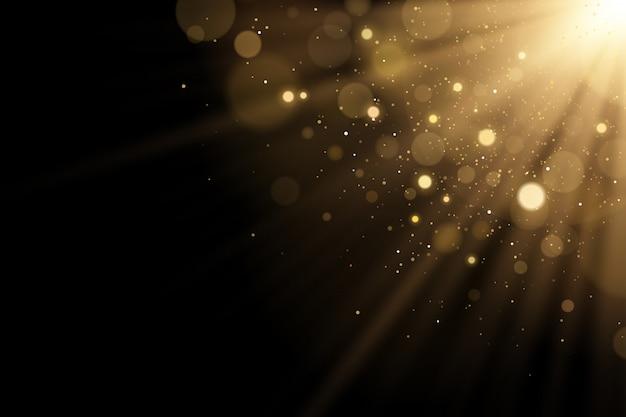 Золотая вспышка света с бликами боке с блестками на черном фоне. лучи света