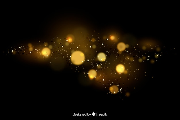 Golden floating particles effect with black background