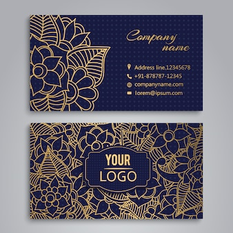 Golden flowers on blue background business card desig
