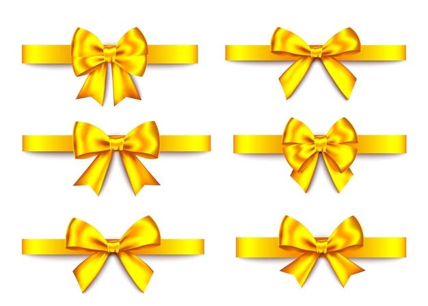ゴールデンギフト弓コレクションは、白い背景で隔離。クリスマス、新年、誕生日の金の装飾。バナー、グリーティングカード、ポスターの現実的な装飾要素をベクトルします。