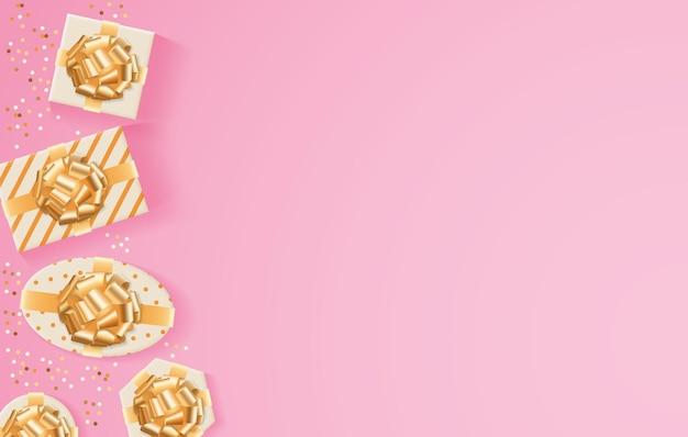 Золотые подарки на розовом фоне
