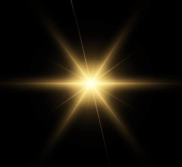 Golden glowing light explodes. bright star.