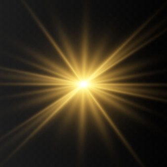 Golden glowing lights effects isolated on transparent background. flash of the sun with rays and searchlight. the glow effect. the star burst into brilliance.