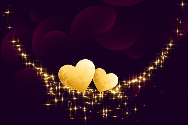 Golden hearts with sparkles on dark background