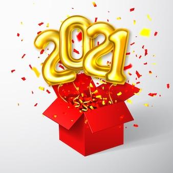 Золотые гелиевые шары с цифрами, летящими из красной коробки и конфетти
