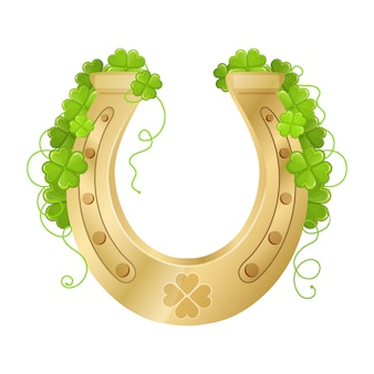 Golden horseshoe with clover. good luck, fortune symbol.