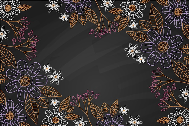 Golden leaves and flowers on blackboard background
