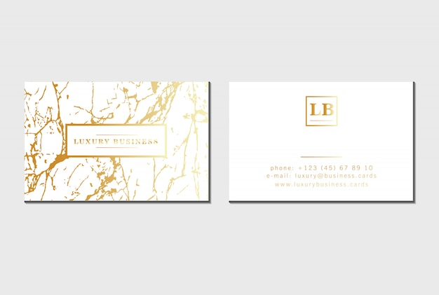 Golden luxury business cards with marble texture, gold foil details.