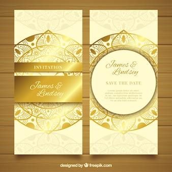 Golden luxury wedding invitation in mandala style