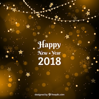 Golden new year background with stars with bokeh effect